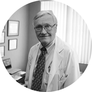 Dr. Agnew standing in his office
